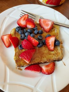 Healthy French Toast with berries on white plate